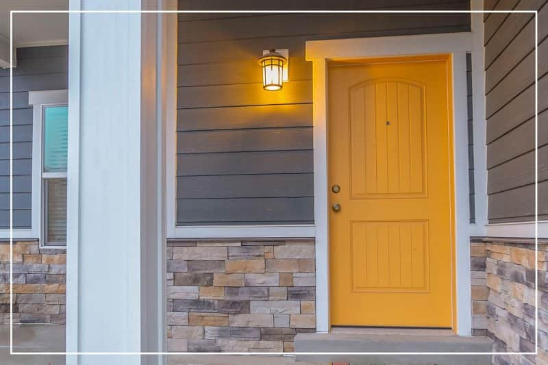 sunburst yellow front door  (Photo by Jason Finn/iStock/Getty Images Plus via Getty Images)