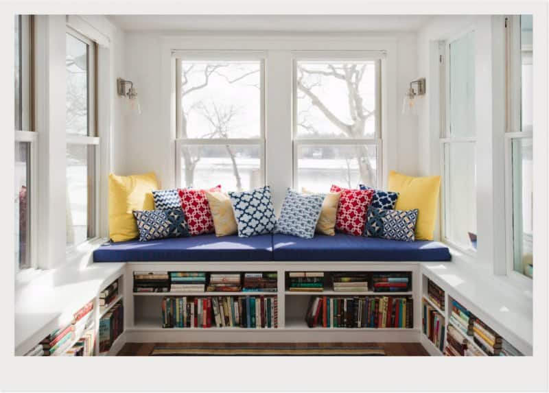 sunroom with mini library in bench (Photo by © Kraus Associates)