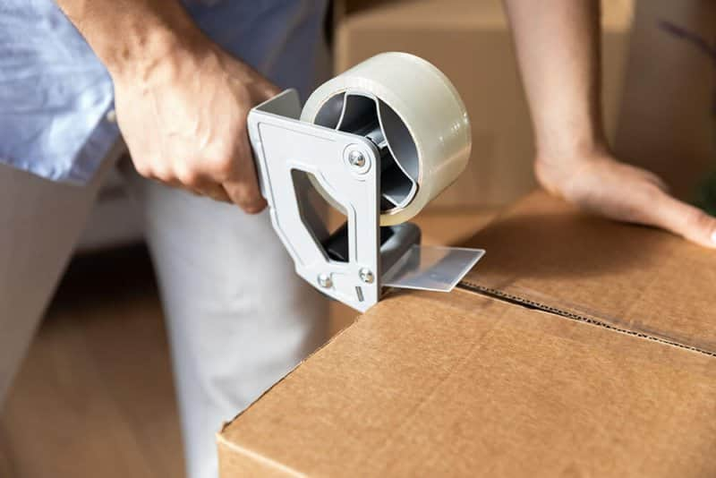 Hand taping box (Photo by fizkes/iStock/Getty Images Plus via Getty Images)