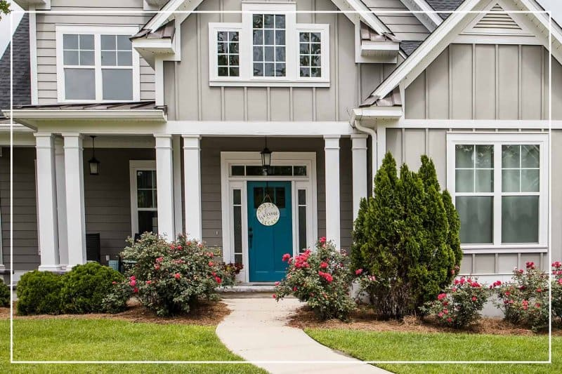 teal front door  (Photo by ucpage/iStock/Getty Images Plus via Getty Images)