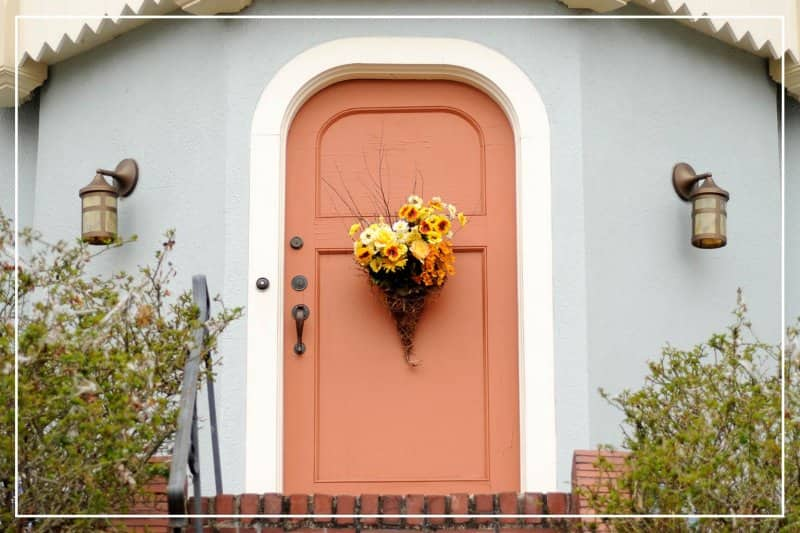 terracotta color front door  (Photo by SondraP/E+ via Getty Images)