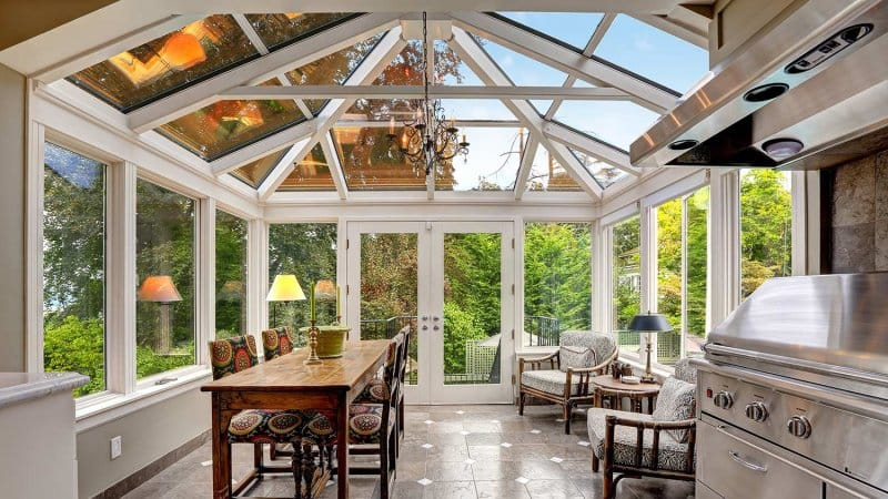 Sunroom with vaulted glass ceiling (Photo by Iriana Shiyan - stock.adobe.com)