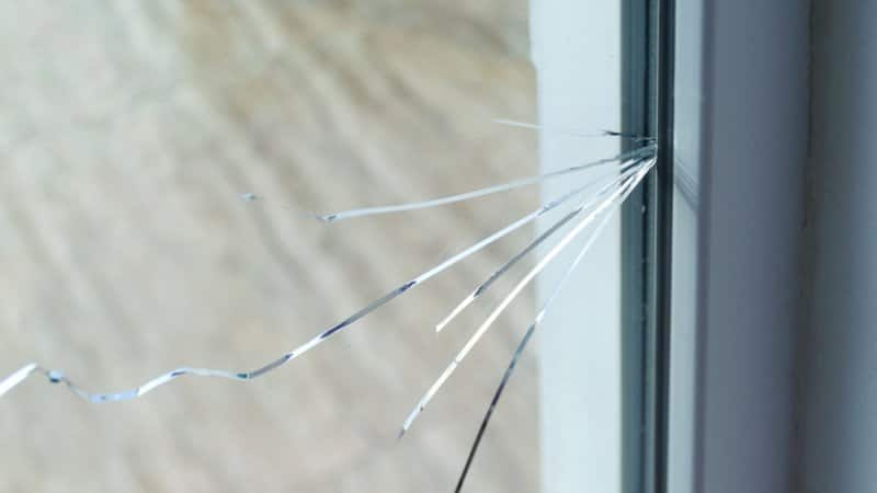 Windowpane with large crack (Photo by Lina Mo/Shutterstock.com)