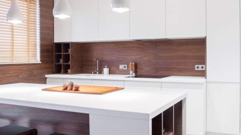 Dark wood backsplash in white kitchen (Photo by Photographee.eu/Shutterstock.com)