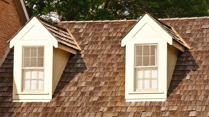 Two dormers on wood shaker roof (Photo by dbvirago - stock.adobe.com)