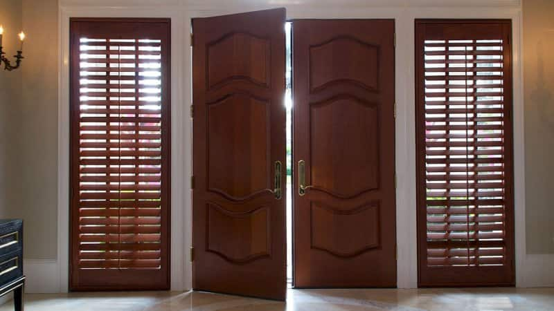 Wood shutters flank front door (Photo by Stephen Orsillo - stock.adobe.com)