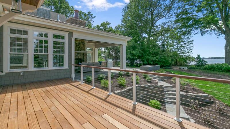 wooden deck lake house backyard  (Photo by PC Photography / iStock / Getty Images Plus via Getty Images)