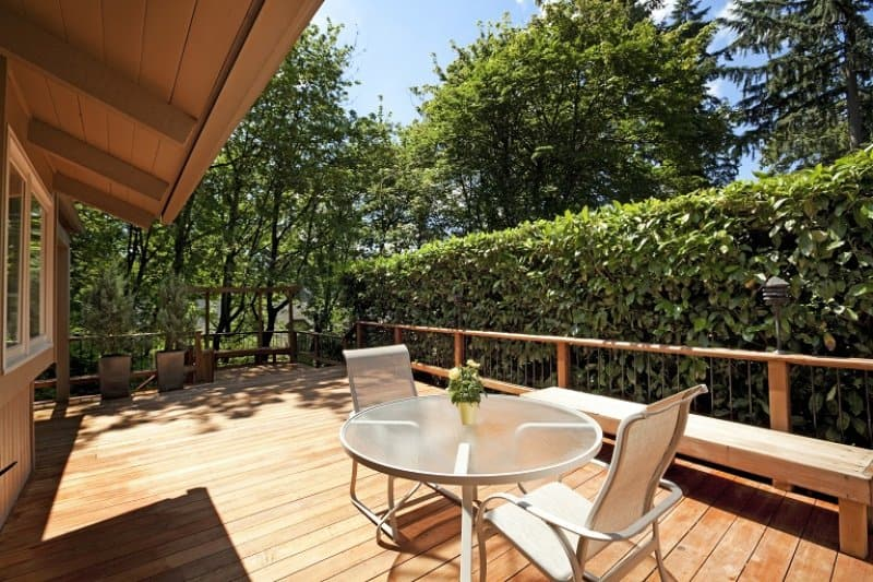 Wooden deck on summer day (Photo by chuckcollier / E+ via Getty Images)