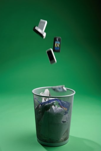 cell phones being thrown in the garbage