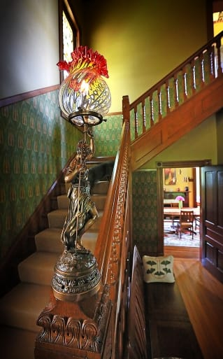 a statute and banister inside an Old Northside home in Indianapolis