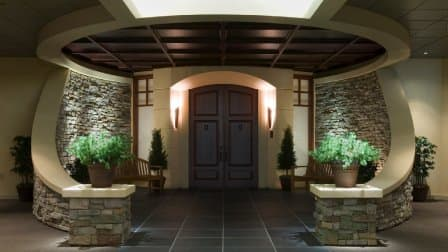 Circular entryway with door illuminated across the top and sides