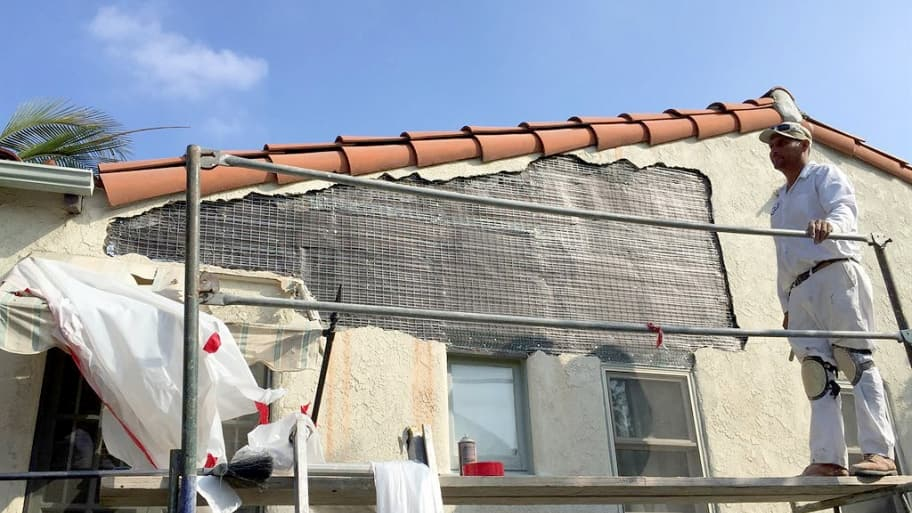 a contractor working on stucco repair