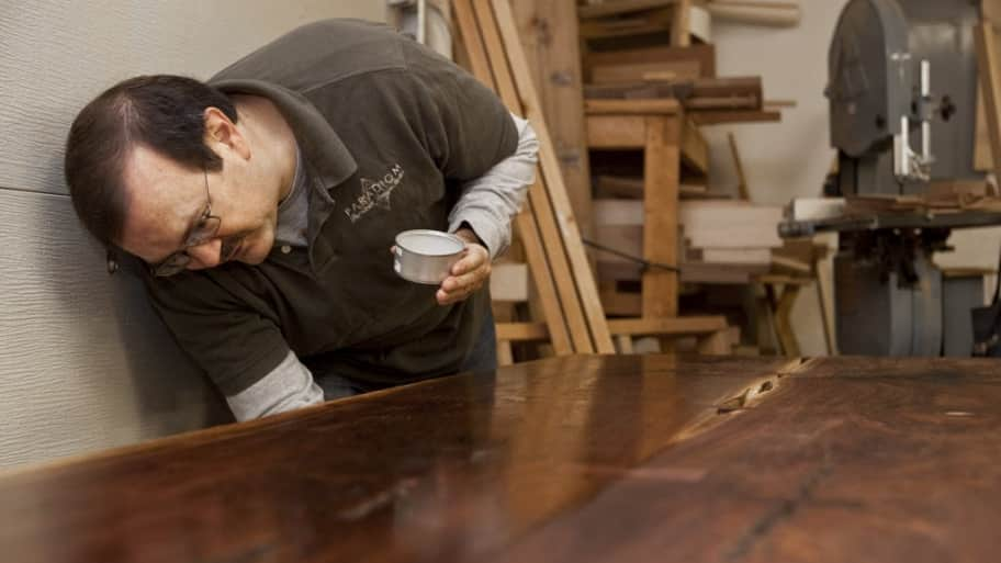 a man working on a wood table