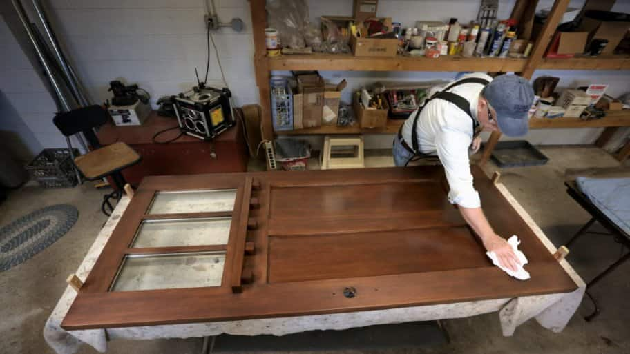 Finishing an old door at The Front Gate in Indianapolis