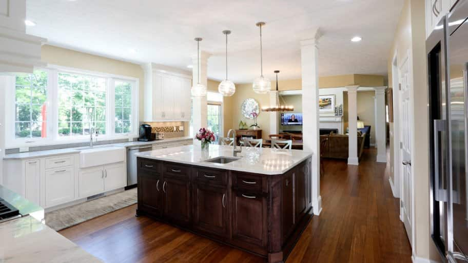 A white kitchen with wood floors