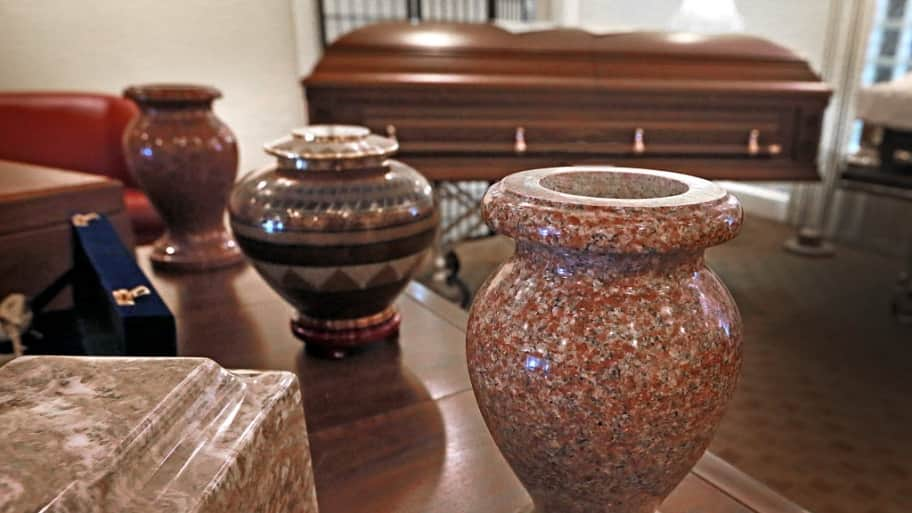 cremation urns and a casket