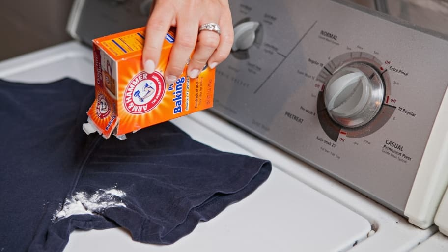 person pouring baking soda on t-shirt