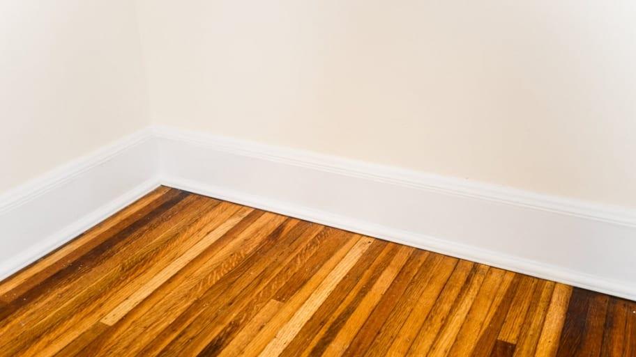 white baseboards on hardwood floor