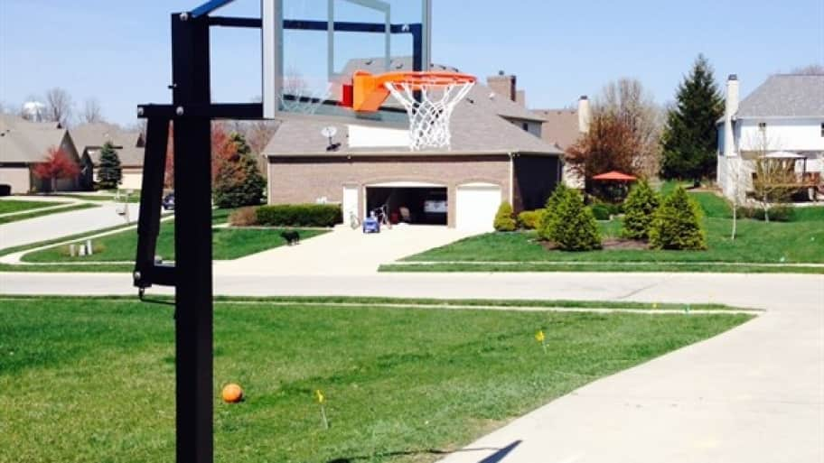 basketball hoop in front of a home