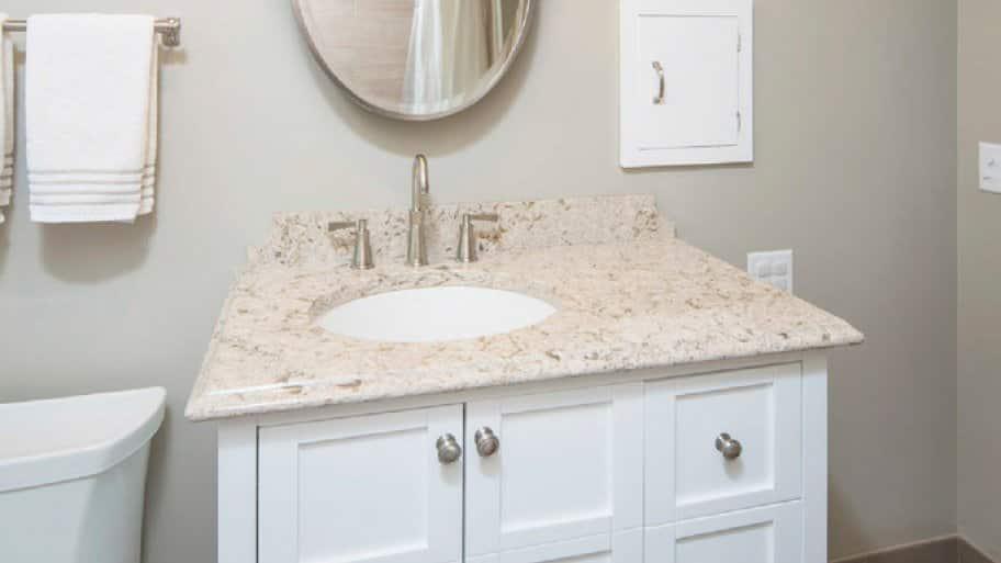 White bathroom vanity with granite countertop