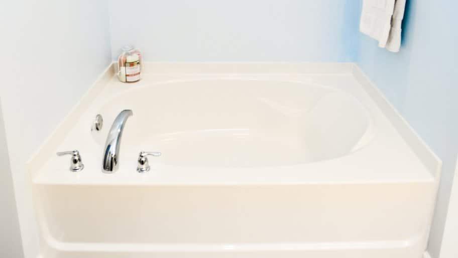 garden bathtub in bathroom with pale blue walls