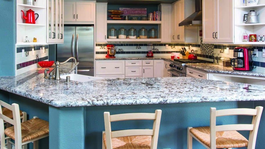 kitchen with granite countertops, tile backsplash and open-faced cabinets