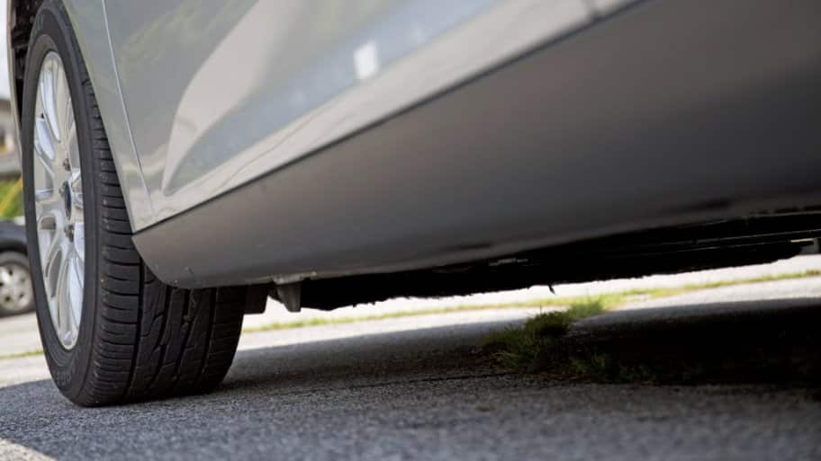 Car tire on pavement
