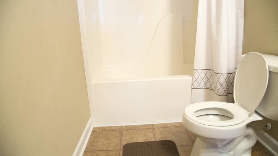 refinished bathtub in small bathroom