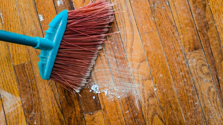 broom sweeping a floor