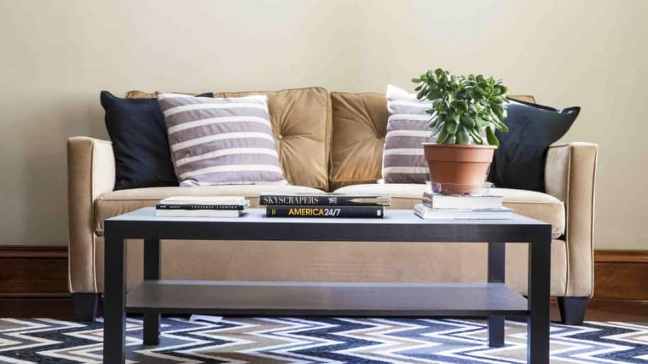 coffee table in front of brown couch