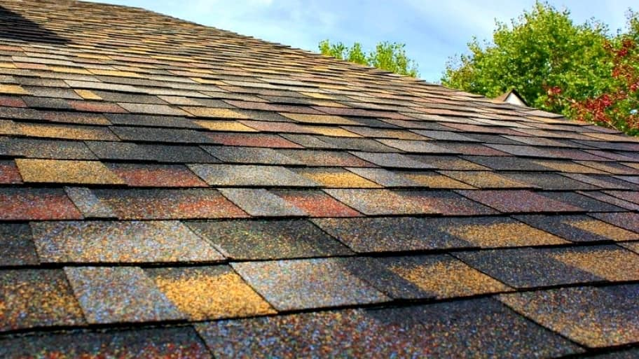 Snow and ice can damage shingles on your roof. Problems often won't be obvious until the weather warms up. (Photo by Angie's List member Brad K.)