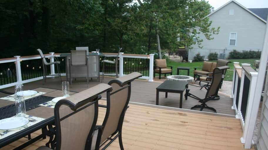 two-level deck with dining table and other nearby seating.