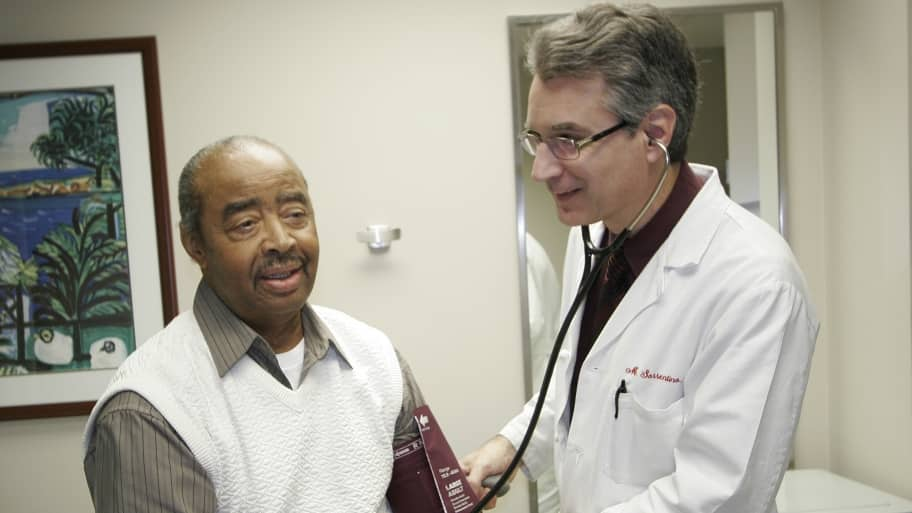 doctor takes patient blood pressure