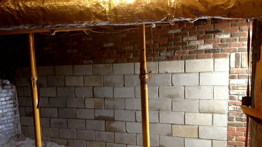 A home's foundation is repaired