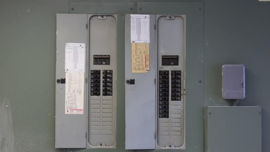 two gray electric panels side by side
