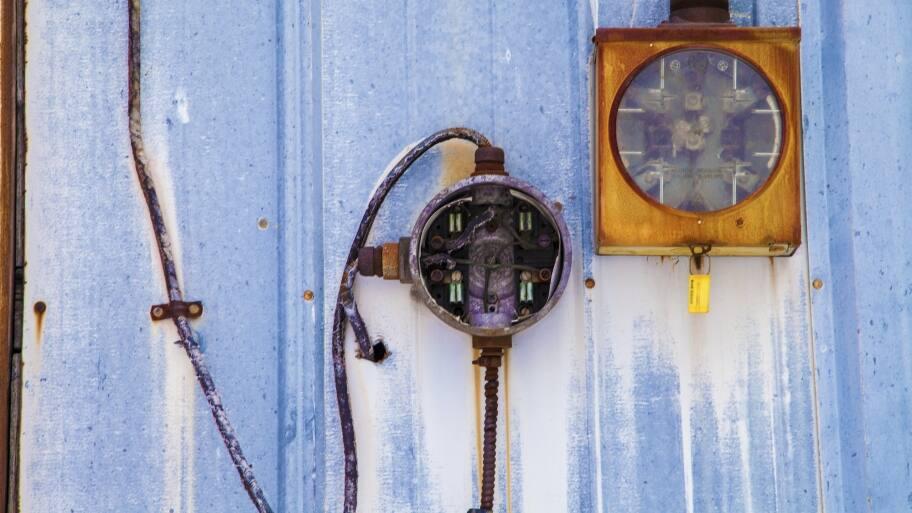 broken old home electrical meters covered in rust