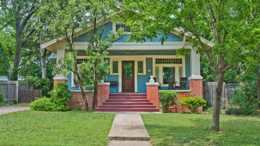 craftsman bungalow house with blue paint job