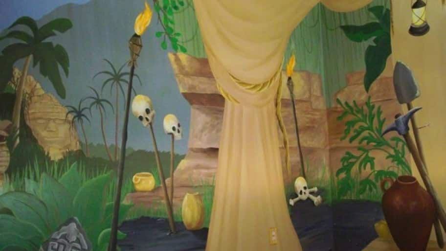 indiana jones themed mural on kid's bedroom