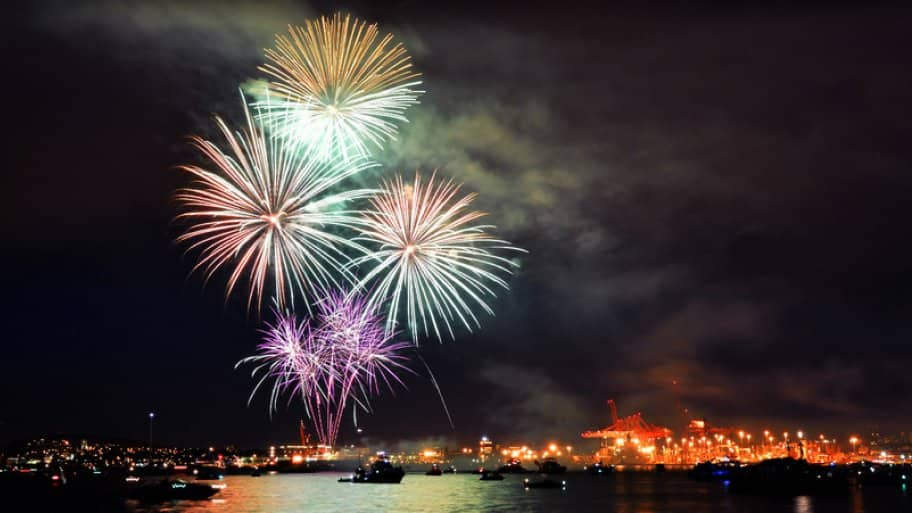Fireworks over boats in the water.