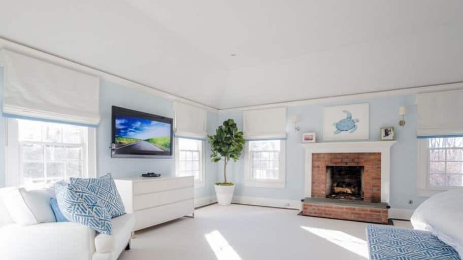 flatscreen tv in white and blue bedroom