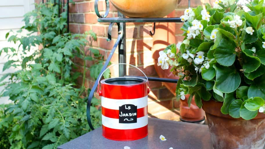 paint can repurposed as hose storage