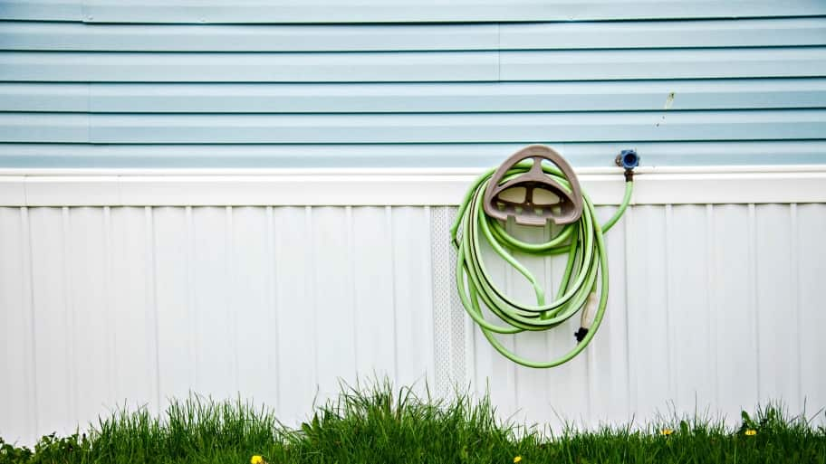 garden hose hanging on wall