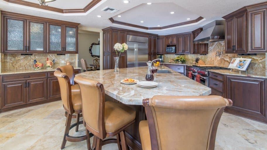 kitchen with granite countertops and island seating