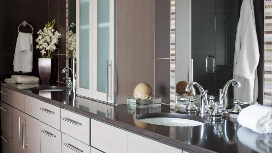 gray bathroom sink vanity with mirrors