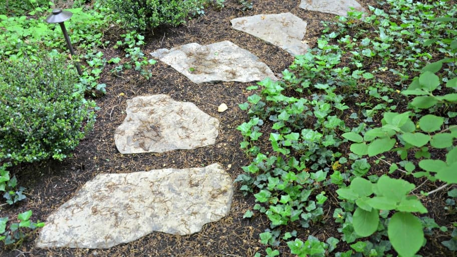 Stone pavers and ground cover plants that need little watering can replace grass in your yard. (Photo by Roger Tunis)
