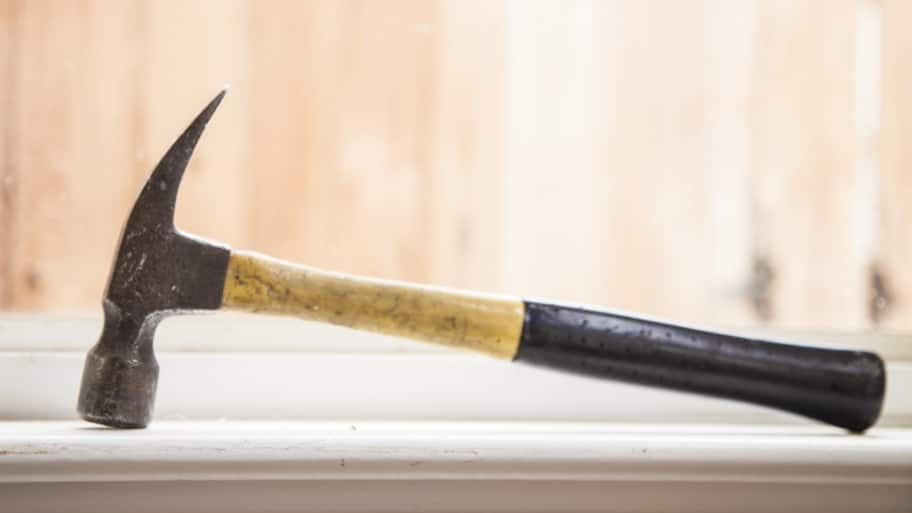 contractor's claw hammer sitting in window sill during remodeling project