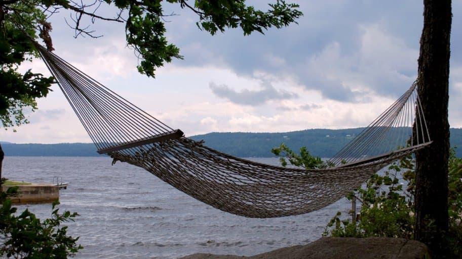 A hammock by a lake