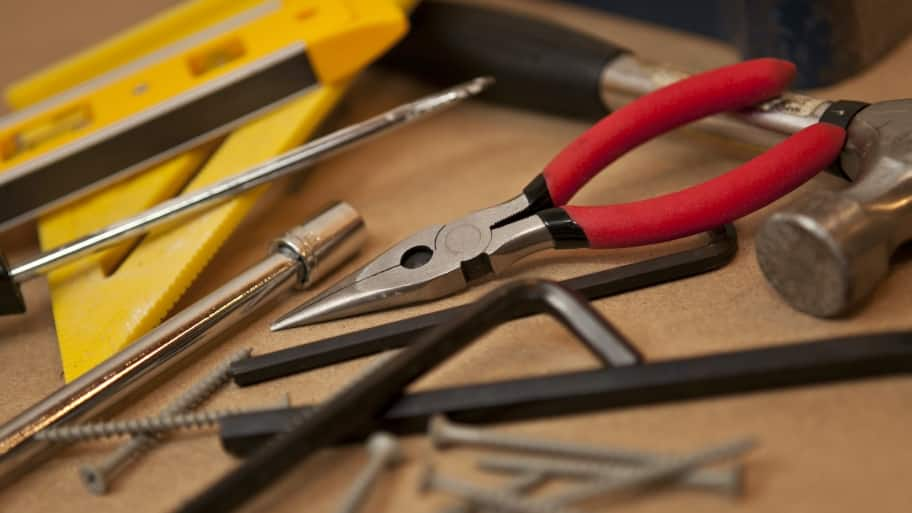 needle nose pliers with screws and other tools