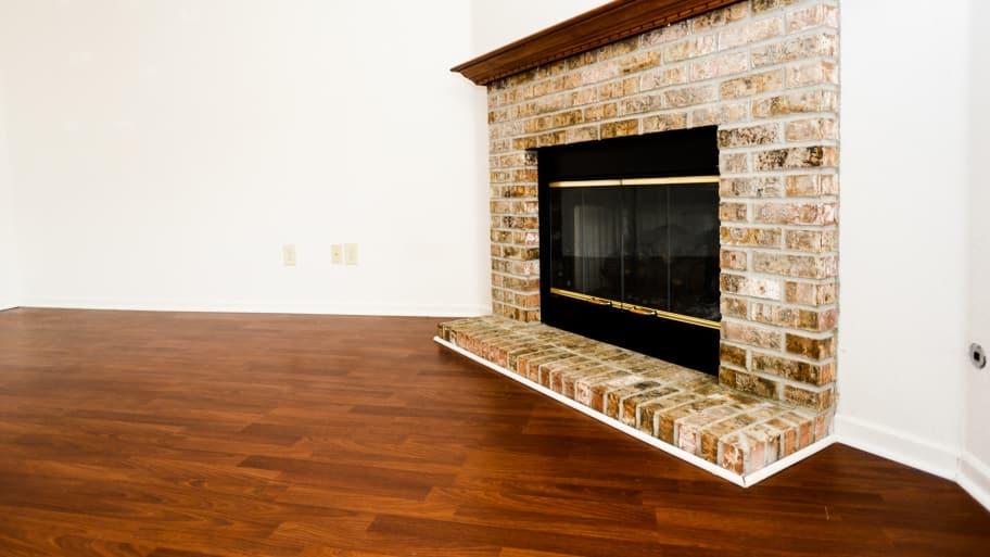 hardwood flooring and fireplace