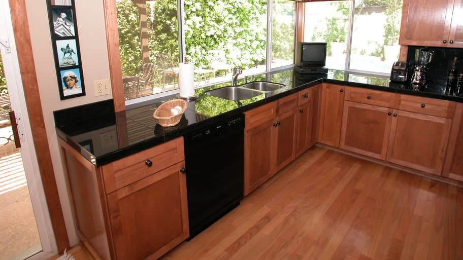 cherry hardwood floors and cabinets in kitchen
